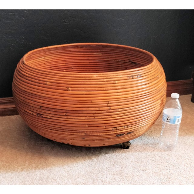 Vintage Gabriella Crespi Style Mid Century Rattan Tiki Bamboo Coiled Pencil Reed Planter on rollers. Recalling the work of...