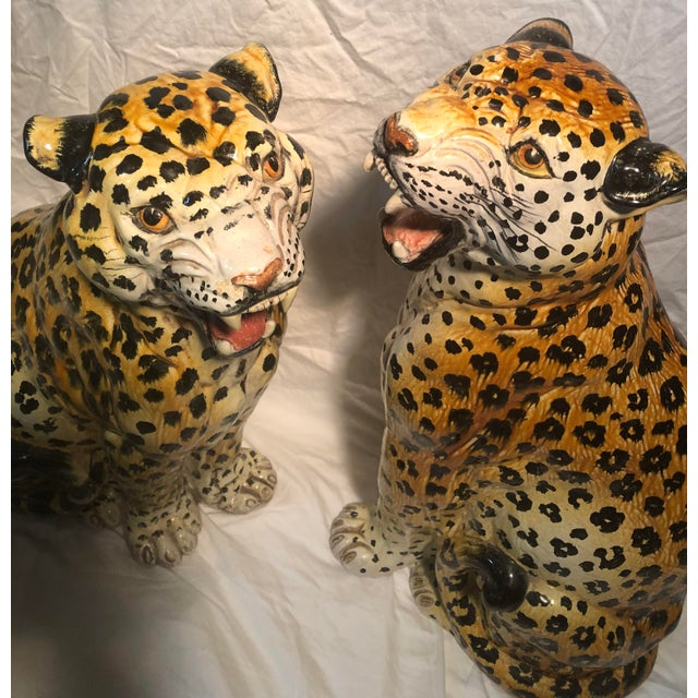 Amazing pair of Mid Century terra-cotta glazed Leopards larger one is 24 High 14.25 wide & 9.5 deep Smaller one is 23 high...