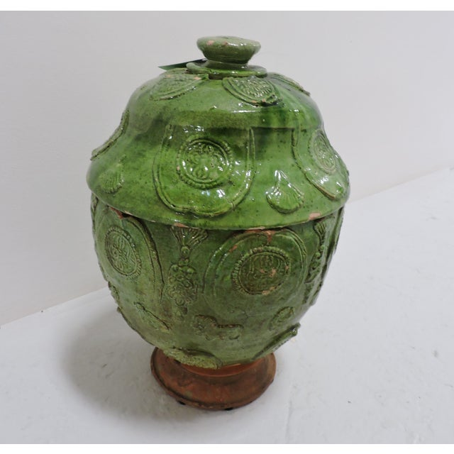 A brilliant green-glazed ginger jar in the style of Sung Dynasty (960-1279) pottery. The inside of the jar and lid are...