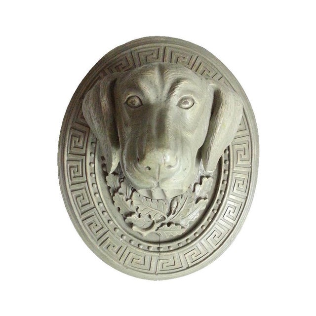 Dog head wall hanger is rounded with Greek Key and bottom is decorated with oak leaf. Antique wood wall hook shows owner's...