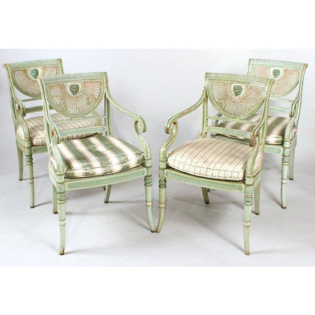 This listing presents four Nineteenth Century painted Regency chairs. The chairs feature wonderful original green...