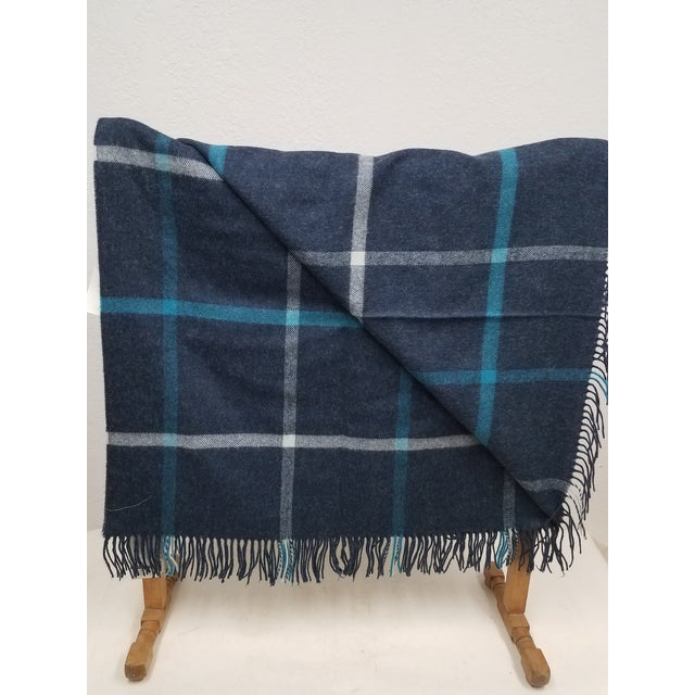 Merino Wool Throw Blue and Aqua - Made in England A fun and versatile throw in an aqua blue and white square design made...