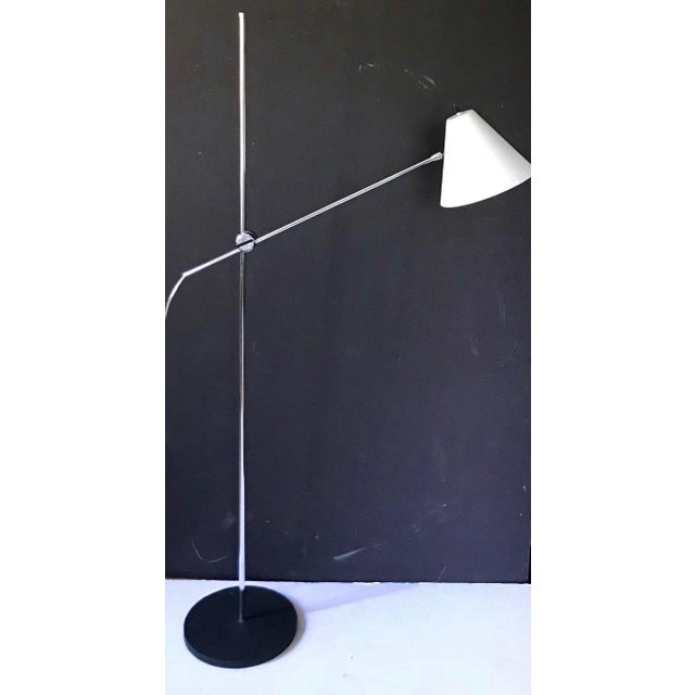 An adjustable arm floor lamp made for George Kovacs in the 1960's and labeled under the cast steel base. The lamp is in...