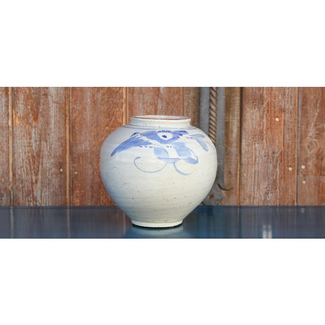 Lovely Vintage Porcelain Jar with blue foliage designs on a white glazed background featuring a globular shape & aged finish.