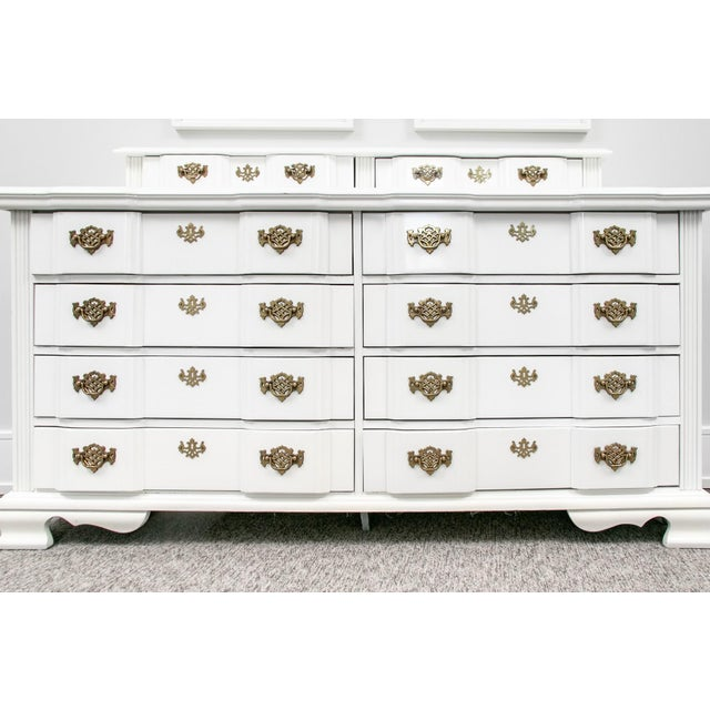 Superb American made chippendale pagoda style dresser with high gloss lacquer paint finish. Fancy batwing drawer pulls;...