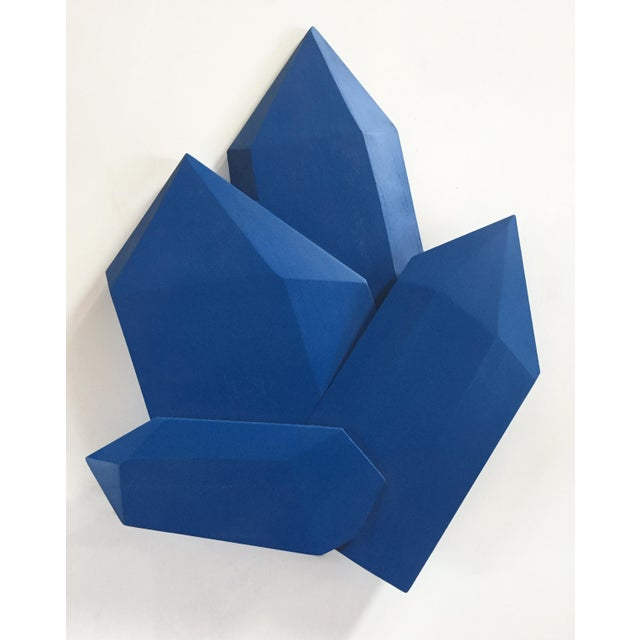 """True Blue Crystals"" is a bright sapphire blue wall sculpture made out of solid wood and then painted and sealed with a UV..."