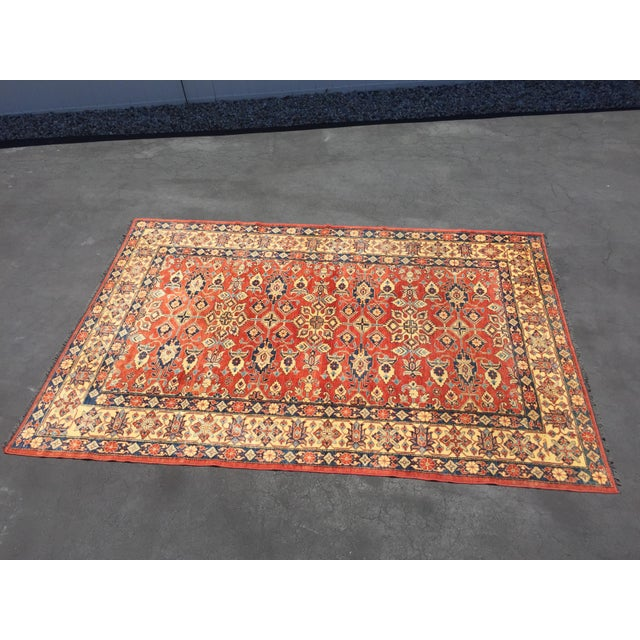 "Vintage Kazak Afghan hand knotted wool rug Rug measures 11'3"" x 7'6"". Rug is in very good condition. There are two areas..."