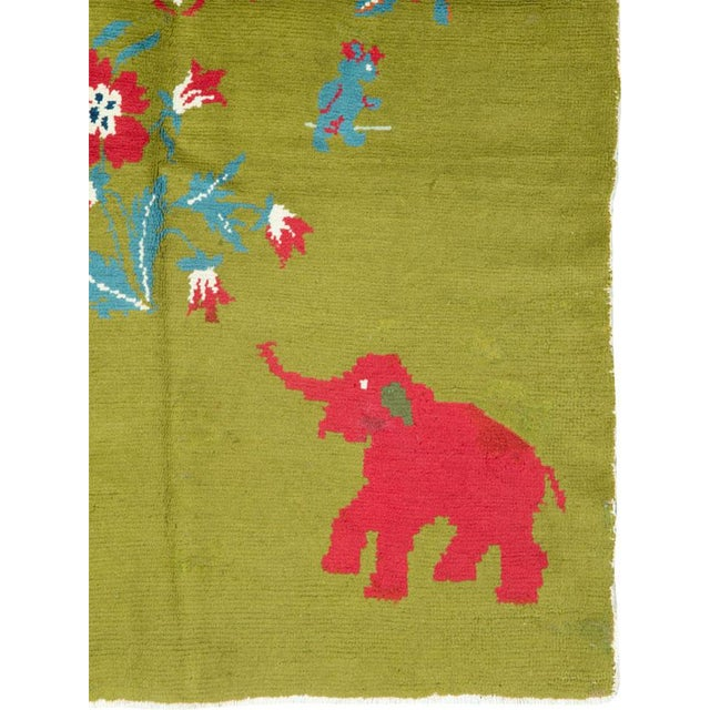 A vintage Swedish pictorial rug from the second quarter of the 20th century depicting elephants. Hand-woven in Europe Wool...