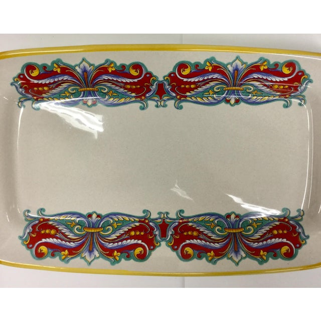 This bowl is vintage. This Italian brand does continue to produce ceramics today but not at this level. Hand-painted and...