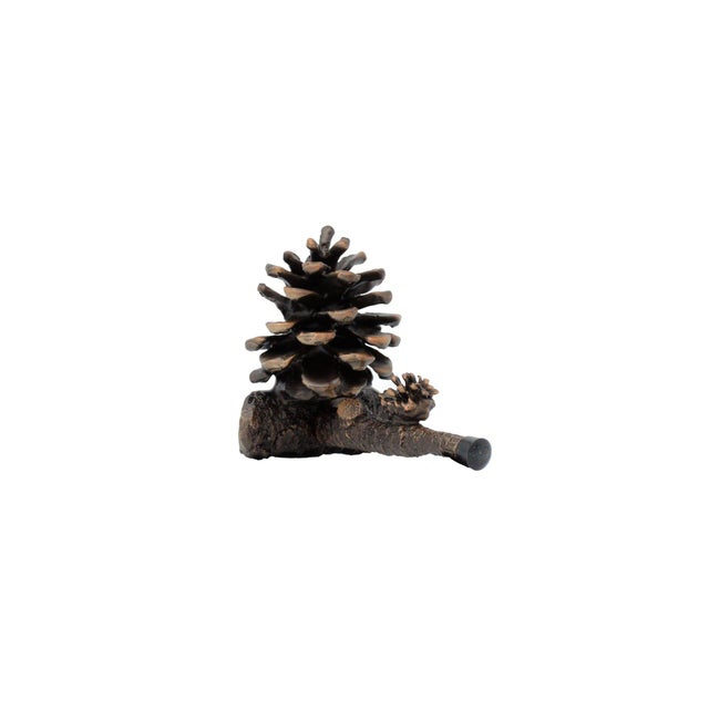 This beautiful, fully open, small, solid bronze Ponderosa pine cone is cast on a short pine branch and secured to the wall...