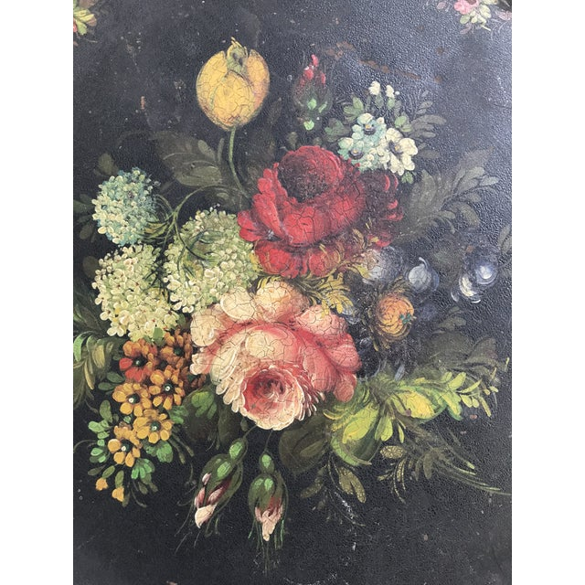 Amazing serving tray from France, 19c. This metal tray is in a black finish with vibrantly colored floral detailing.