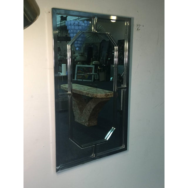 Rectangular modern chrome framed mirror with elongated octagonal chrome framed design center. Designed in the 1970s in the...