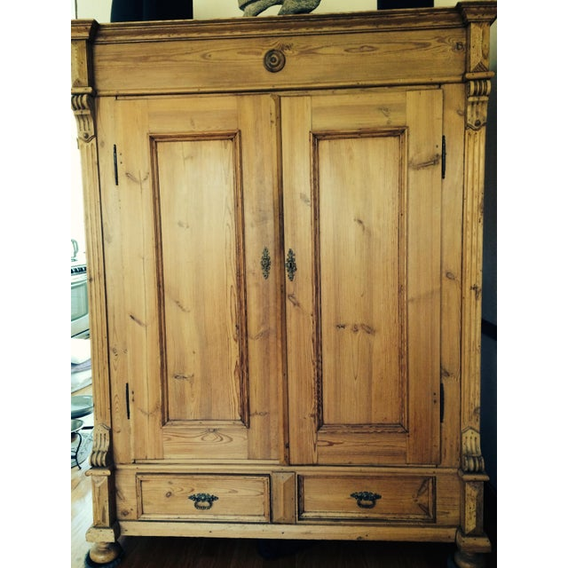 Traditional style. A master carpenter assembled antique German pine armoire. This large armoire will be sure to add...