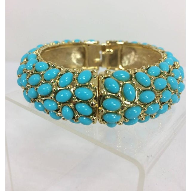 """Kenneth Lane turquoise cabochon encrusted gold clamper bracelet...Approximately 3/4"""" high X 3"""" across, excellent. Due to..."""