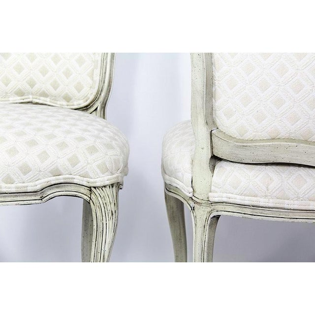 Set of 6 dining chairs in the style of Louis XV with carved wood cabriole legs and featuring durable designer geometric...