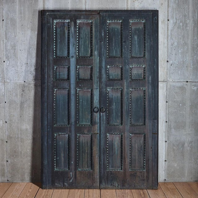 Pair of Monumental late 19th century bronze bank doors, with egg and dart detail and ring pulls. Patinated brown and...