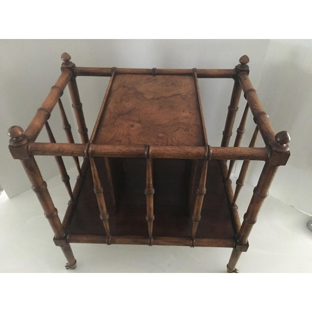 This is a great dual purpose small side table / magazine rack. Burl wood top, brass rolling feet, divided slats for books...