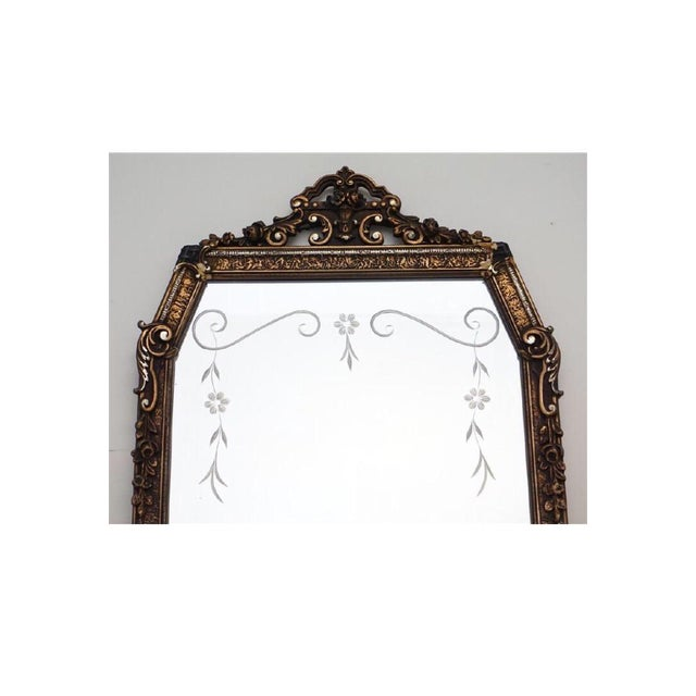 Early 20th c. Etched Glass and Gesso Mirror. Floral swag etched top and scroll wood and gesso frame. Loss to two top...