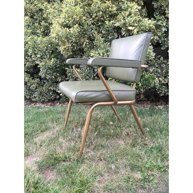 Incredible mid century modern office chair in a fabulous shade of vintage green. It spent its entire life in a school and...