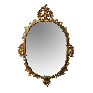 An Elegantly Carved French Louis XV Style Rococo Giltwood Oval Mirror For Sale
