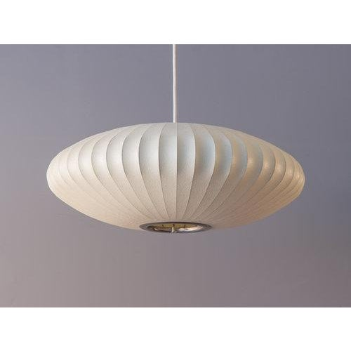 Vintage Howard Miller Bubble Lamp by George Nelson. This iconic lamp is composed of a steel wire frame covered in a...