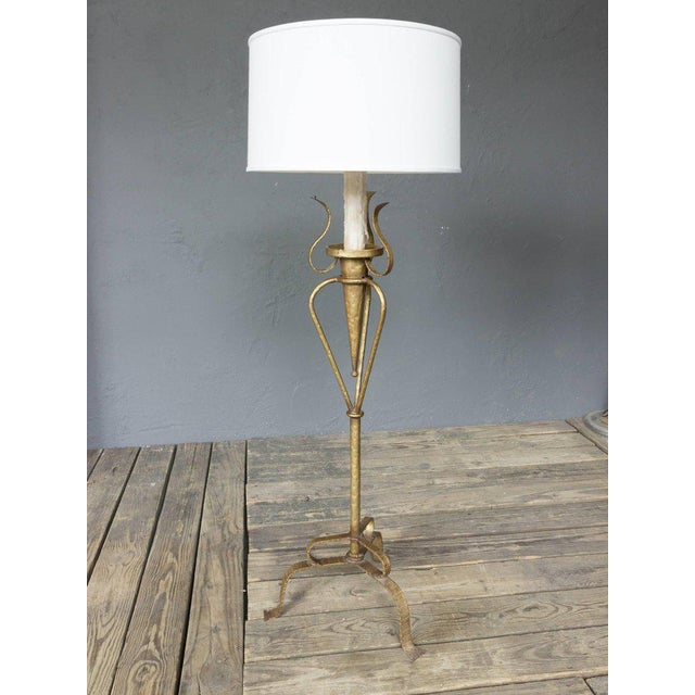 Gilt metal floor lamps on a tripod base. Spanish 1950s. The price includes new wiring, not sold with shade.