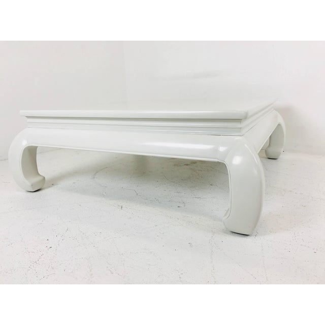 """Lacquered Ming style coffee table. Table is in good with wear due to age and use. Dimensions: 42"""" wide x 42"""" deep x 16"""" tall."""