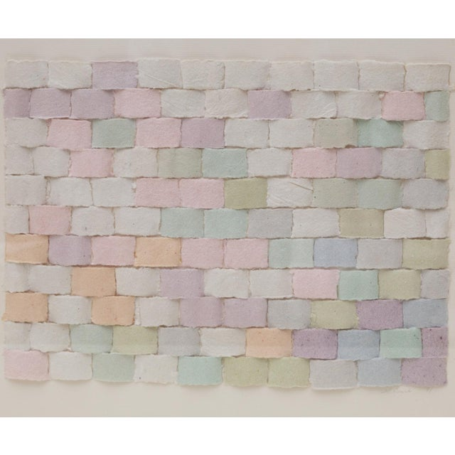 Wonderful vintage 1990's handmade sculptural paper collage featuring varied pastel hues of handmade paper strips in a...