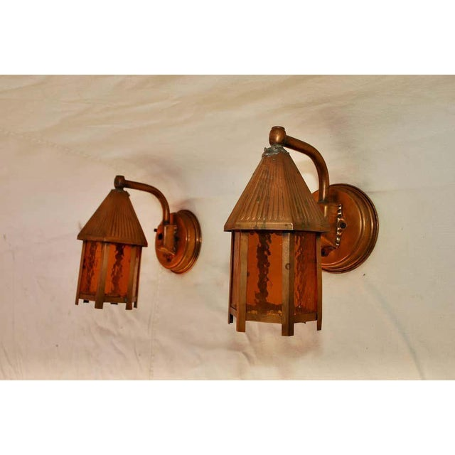 Adorable pair of 1940s outdoor copper sconces.