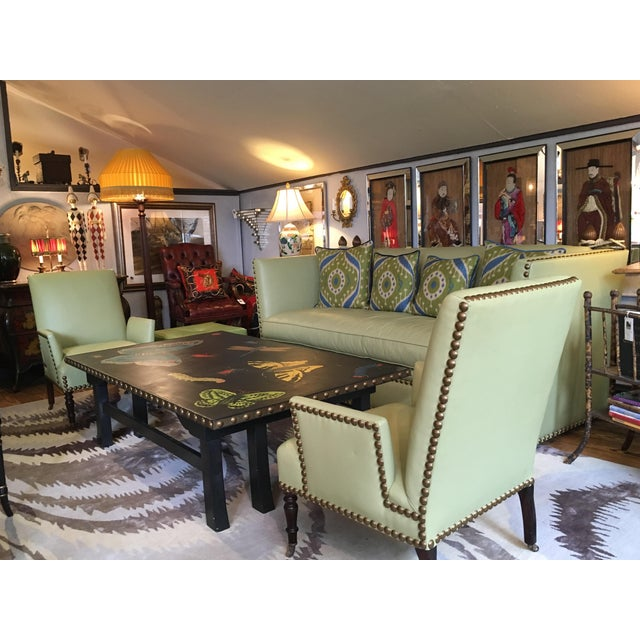 Super chic pair of soft lime green leather club chairs with a Mid-Century Modern sleek compact shape, having slightly...