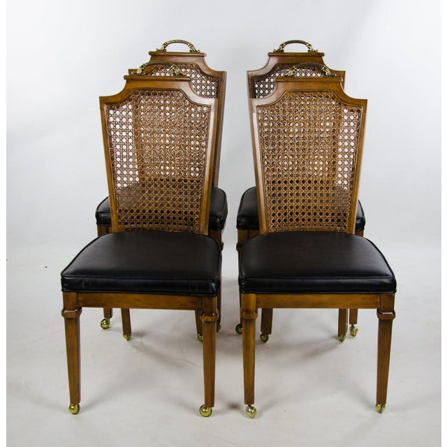 Update your dining room seating with a touch of elegance and rustic flair with this set of 4 late 19th c. French Regency...