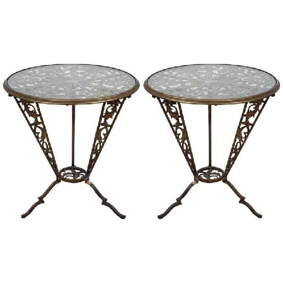 A vintage pair of Art Deco occasional tables in gilded wrought iron, produced circa 1930s by Karl Hagenauer for Rena...