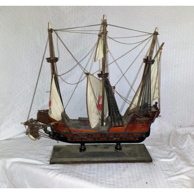 This antique wooden carved ship model or Galleon is old with dust and age. Made from real wood and canvas and string with...