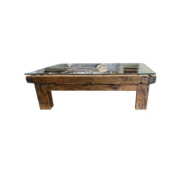 A antique rustic rectangular Mexican jail door coffee table with a thick tempered glass top. This coffee table charms our...