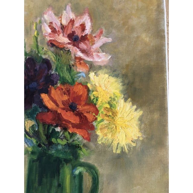 This Impressionist still life painting features a green pitcher full of assorted colorful flowers. Each detailed stroke...