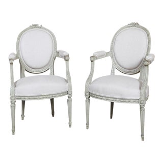 Antique Pair of French Louis XVI Painted Upholstered in Linen Armchairs For Sale