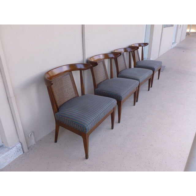 4 Mid Century Hollywood regency klismos slipper chairs sold as found showing normal signs of wear to finish but overall in...