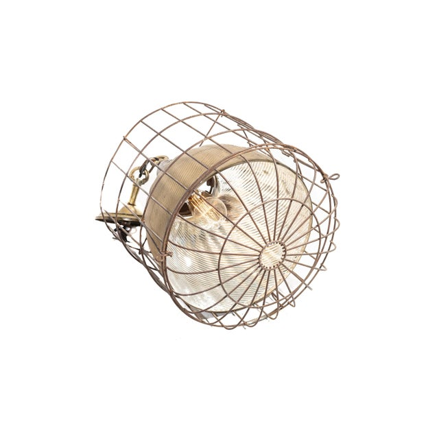 This Rare industrial dental lamp features a gold colored mercury glass shade secured in a cage. Though mercury glass...