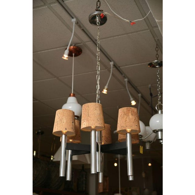 Elegant and handsome mid-century modern chandelier with six long chrome tubular candle arms connected by black patinated...