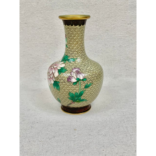 Beautiful vintage cloisonne vase. Floral detailing. Features several different flowers and a geometric pattern band on the...