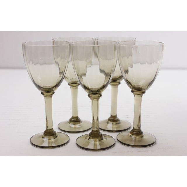 Set of five Mid-century French port glasses in smokey brown. Light wear.