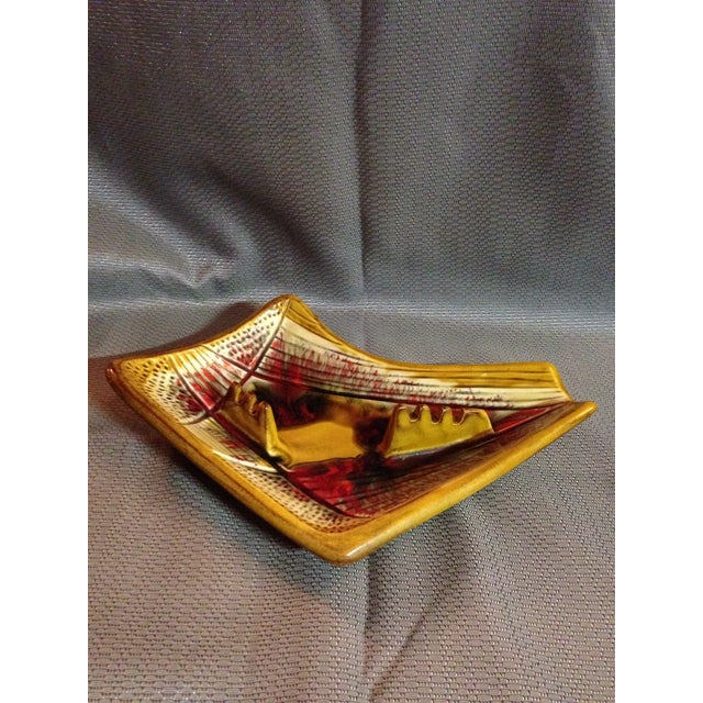Red and yellow vintage ashtray in excellent condition by California Pottery USA.