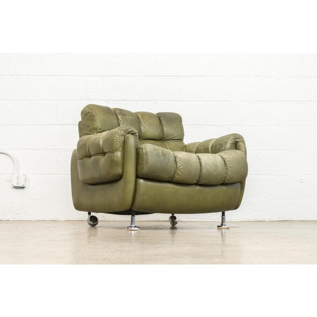 This incredible vintage leather lounge chair in the style of Brazilian mid century modern designer Percival Lafer or Jean...