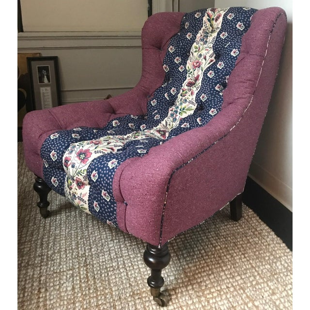 Upholstered tufted chair in custom Tilton Fenwick for Duralee fabric with turned wood legs on casters. As seen in Country...