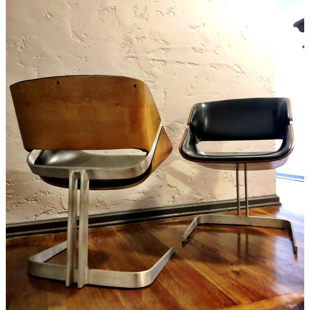 Stunning pair of plycraft bent plywood chairs. Simplicity in materials and form, the chairs are exquisite examples of the...