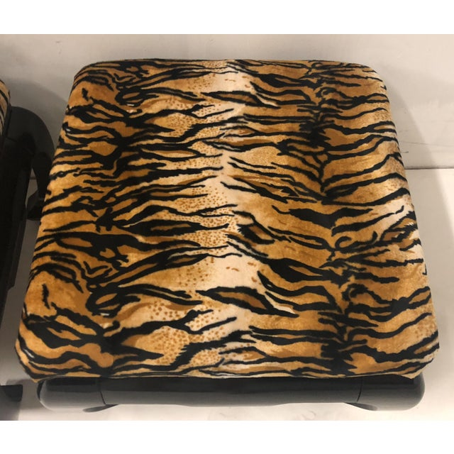 Pair of Karl Springer style Asian modern ottomans with newly black lacquered frames and new tiger velvet upholstery.