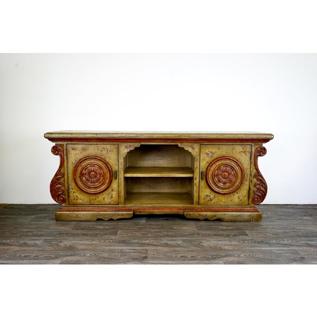 A showroom item that we're looking to find a beautiful home. Features hand carved features, hand-painted patina finish,...