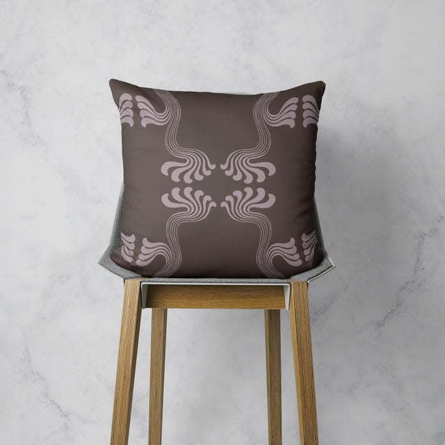 Because philosophy. This pillow draws on the Art Nouveau movement for a highly stylized print in sinuous forms and muted...