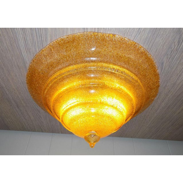 Thick Italian glass shade in a warm Amber color on this flush mount ceiling light fixture. Hand blown, Rugiadoso or...