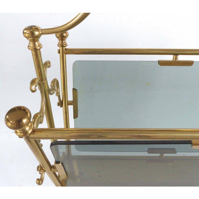 Available this magnificent 1970s Fontana Arte brass and smoked glass magazine holder caddy created in the Hollywood...